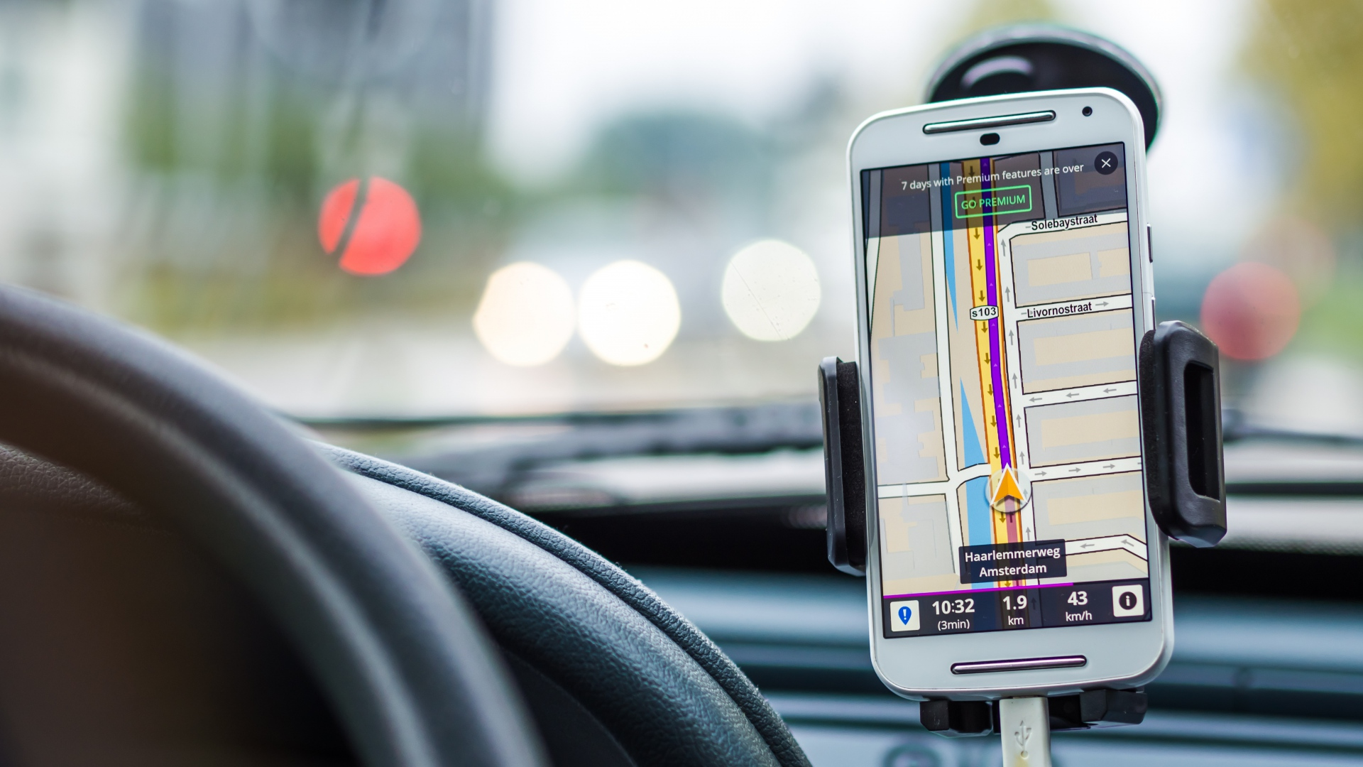 Is it Illegal to Use a Smartphone as a Satnav or Music Player While Driving?